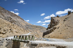 Small steel bridge across river in mountains Royalty Free Stock Photo