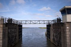 Small steel bridge over lock chamber Royalty Free Stock Photos