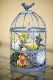 Small Easter ornament in a cage Royalty Free Stock Images