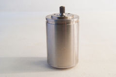 Small steel motor on a white background.  royalty free stock image