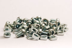 Small steel nuts and bolts Stock Photos