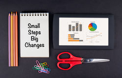 Small Steps Big Changes. Tablet, pencils, scissors, paper clips Royalty Free Stock Images