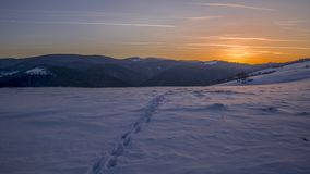 Small Steps in the snow. Sun is going to sleep and small steps remains in the snow stock photo