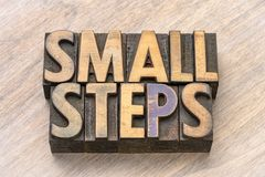 Small steps word abstract in wood type. Small steps word abstract in vintage letterpress wood type printing blocks royalty free stock photo