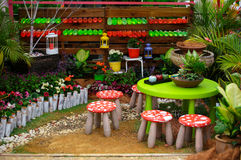 Small stolls and table in a beautiful garden arrangements at FLORIA 2014 Stock Photos