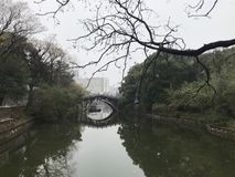 Small stone arch bridge By the lake. It is a clear demonstration of the artistic features of Jiangnan landscaped gardens. For example, the charming landscape royalty free stock photo