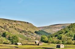 Small stone barns on farmland Royalty Free Stock Images