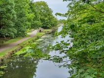 A small stone bridge along the Leeds to Liverpool Canal royalty free stock images