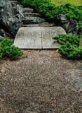 Small stone bridge in garden royalty free stock photos