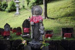 Small stone buddha monk statue call jizo in Japanese. Small stone buddha monk statue call jizo view in Japanese royalty free stock images