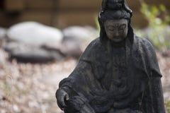 Small Stone Buddha Statue Stock Photo