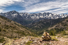Small stone cairn and Asco mountains in Corsica Royalty Free Stock Images