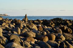 Small stone figure at a stone beach Royalty Free Stock Photo