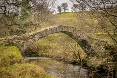 Small stone foot bridge over a little stream. royalty free stock photo