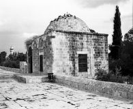 Guardhouse On The Temple Mount. A small stone guardhouse on the eastern side of the Temple Mount in the Old City of Jerusalem in Israel. The Dome  A minaret is Royalty Free Stock Images