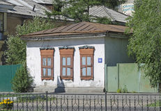 Small stone house with closed shutters on the central street of Chita Stock Photography
