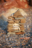 A small stone House construction   on beach background Stock Images