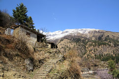 Small stone house lost in mountains. Traditional Tibetan architecture Stock Images