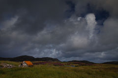 Small stone hut next to a Loch. At North Uist in the Outer Hebrides Stock Images