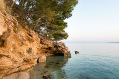 Small stone island in Adriatic sea,  Brela, Croatia. Royalty Free Stock Photography
