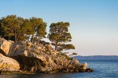 Small stone island in Adriatic sea,  Brela, Croatia. Stock Photos