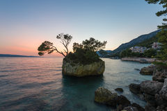 Small stone island in Adriatic sea, Brela, Dalmatia, Croatia. royalty free stock photography
