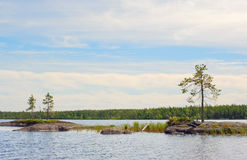 Small stone islands on lake Stock Image