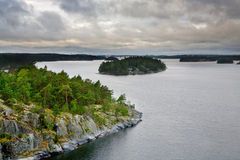 Small stone islands in swedish fiord at sunset Royalty Free Stock Photos