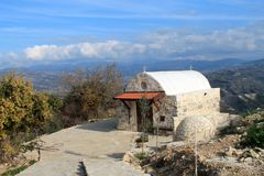Small stone orthodox chapel among the mountains on a sunny day stock images
