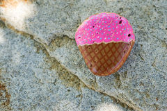 Small stone painted to look like an ice cream cone Royalty Free Stock Photos