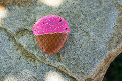 Small stone painted to look like an ice cream cone Royalty Free Stock Images