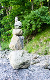Small stone pyramid. With trees in background Royalty Free Stock Photography