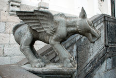 A small stone sculpture of Chimera. On all fours with wings Stock Photos