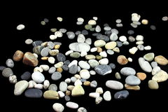 Small stones. All are sea stones on a black background Royalty Free Stock Image
