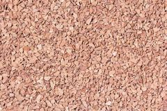 Small stones as background. Dry fragmented pink stones in the background Royalty Free Stock Photo