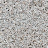 Small stones background. Seamless pattern for design. Background of crushed stone close up. Small stones background. Seamless pattern for design Stock Photo