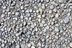 Small stones on a beach. Rock, stones and volcanic lava on a beach of Tiri Tiri Matangi Island. Auckland, New Zealand royalty free stock photos