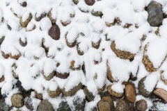 Small stones covered in snow Stock Photography