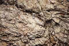Small stones on the cracked mica. Abstract background or texture small stones on the cracked mica stock image