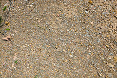 Small stones, gravel, and red dirt Royalty Free Stock Photo