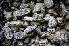 Small stones. Small grey sand stones background Royalty Free Stock Images