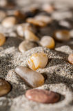 Small stones over sand Stock Image
