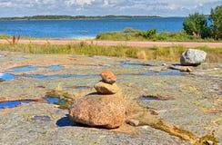 Small stones pyramid on rocky shore of Baltic Sea Royalty Free Stock Photo
