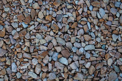 Small Stones Texture. Close-up shot of small and different stones Royalty Free Stock Photo