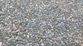 Small stones. There are small stones in the garden. The stones are in different shapes and colours stock photo