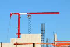 Small storage crane for multipurpose use in construction sites. Small mini hoisting crane for multipurpose use in construction sites, especially for masonry from Royalty Free Stock Images