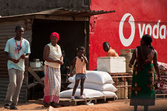 Small store in Mozambique. It was taken in a big market near Maputo, the capital city of Mozambique, Africa. We have the family who runs the store and two Royalty Free Stock Image