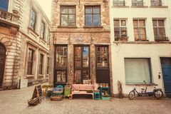 Small store in old style narrow street with restaurants of historical city Stock Images