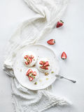 Small strawberry and pistachio pavlova meringue Stock Photos
