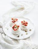 Small strawberry and pistachio pavlova meringue Stock Image